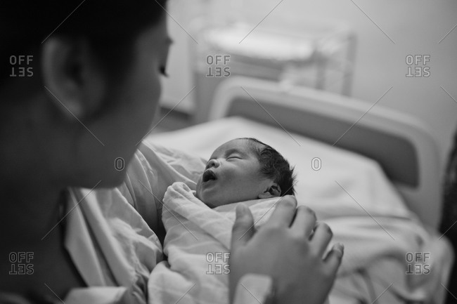 Woman holding a newborn in hospital