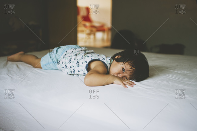 Child lying quietly on a bed