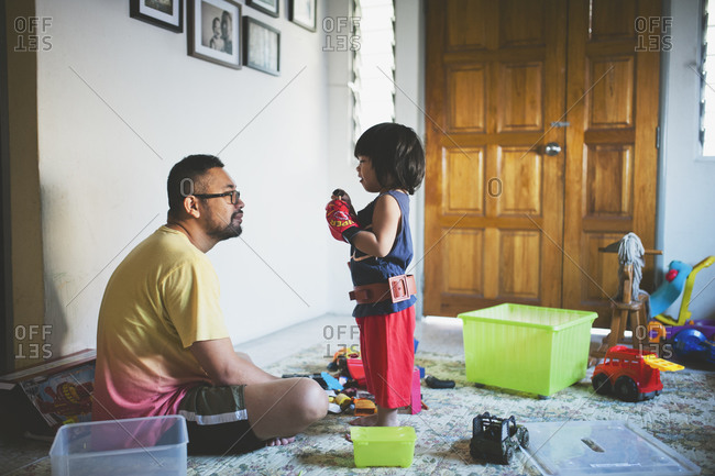 Dad and child playing in their house
