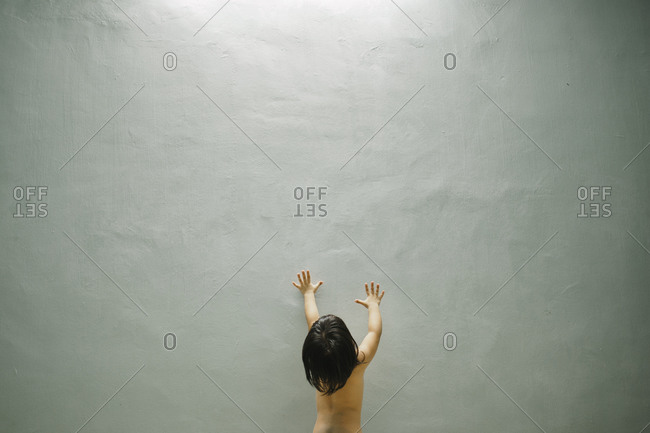 Child reaching up to sunlight