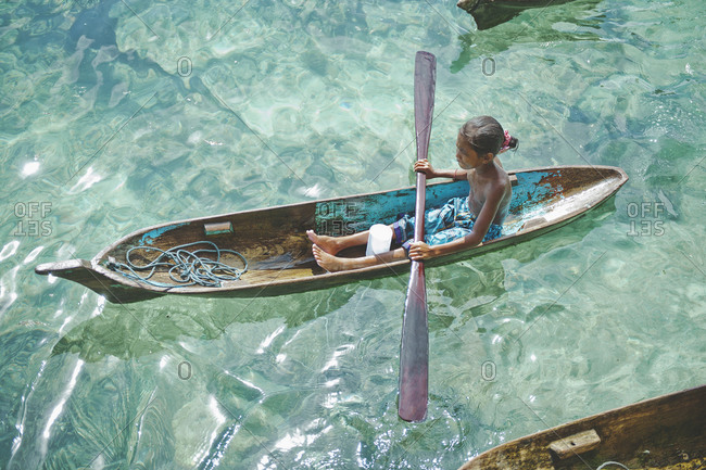 Child of Sama Bajau tribe rowing, Malaysia