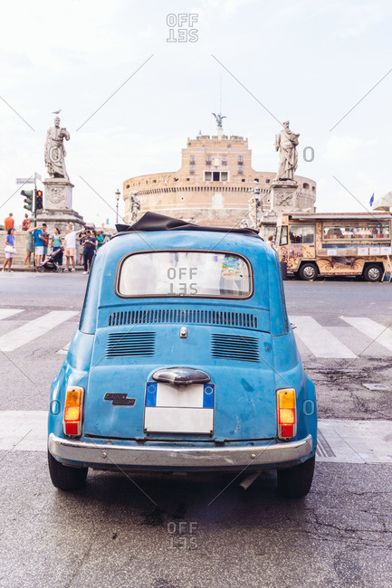 Old car driving in Rome