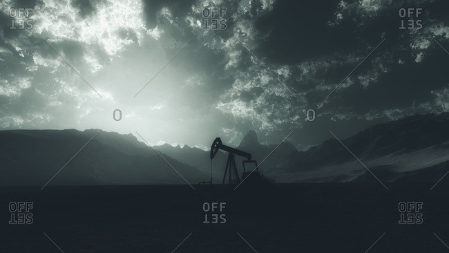 Mountainous landscape with an oil pump jack