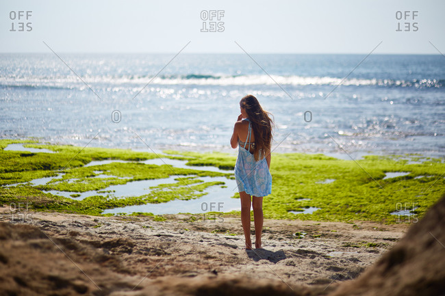 Young woman standing on a seashore