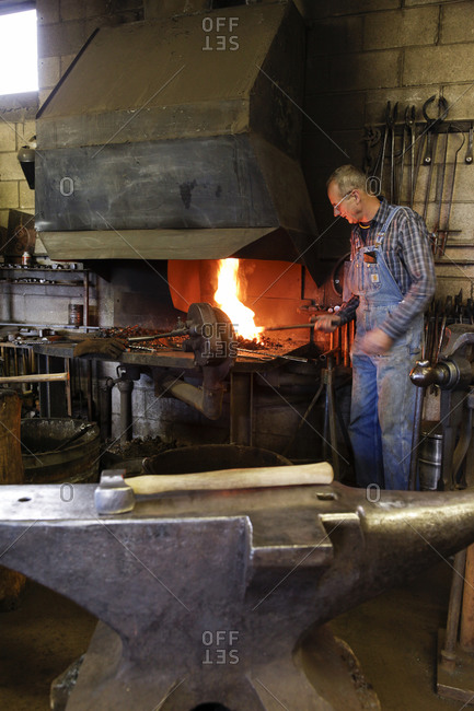 Santa Fe, New Mexico - March 25, 2011: Man working in a blacksmith shop in Santa Fe, New Mexico