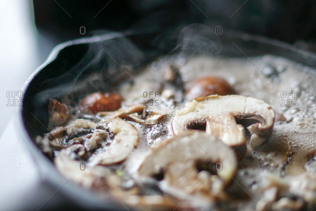 Garlic and mushrooms cooking in a pan