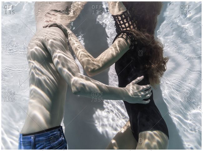 Couple embracing underwater