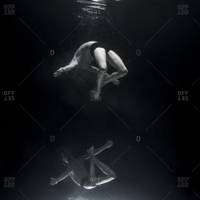 Reflection of an underwater dancers