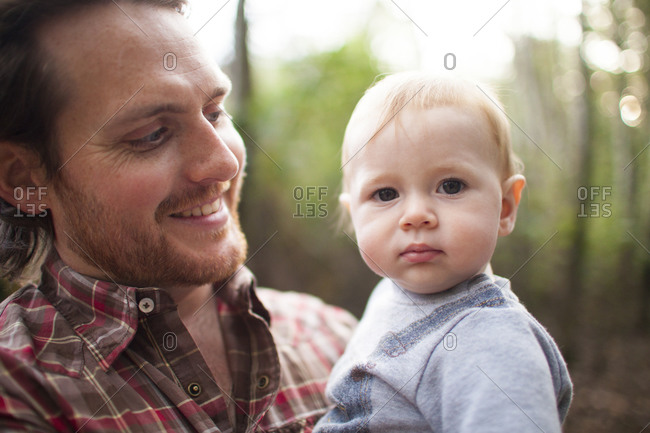 Outdoor portrait of a father holding his son