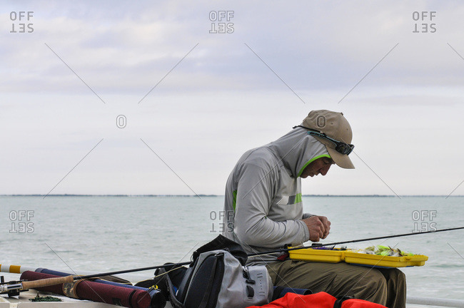 Fisherman selecting the right fly to use to try and catch one of the many species offish in Florida bay