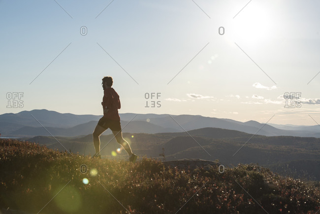 Trail runner high in the mountains of New Hampshire