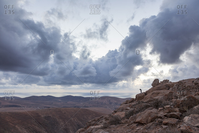 Photographer's silhouette in a rocky mountainous landscape in Fuerteventura, Canary Islands