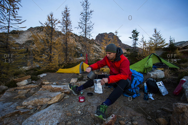 A male camper in the Pasayten Wilderness of Washington in the North Cascades of Washington