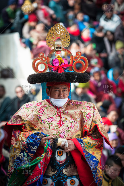 Leh, India - January 7, 2016: Man in costume holding a scepter during a cham dance