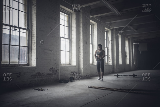 Woman standing in dark gym