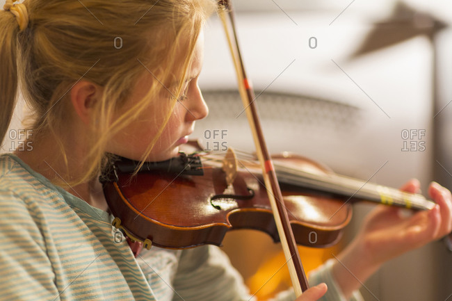 Close up of girl practicing violin