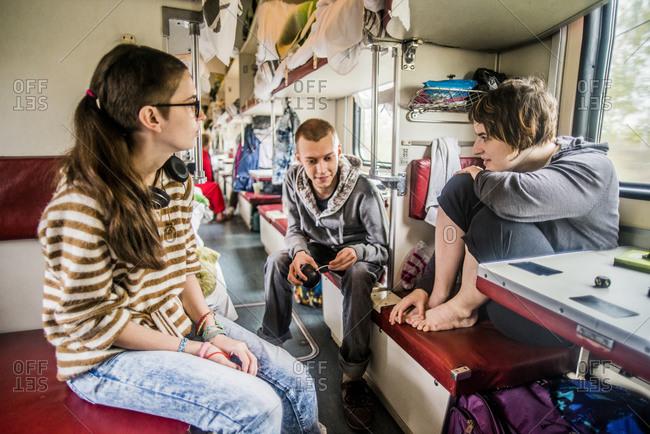Friends talking in train on road trip