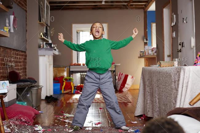 Boy shouting in living room
