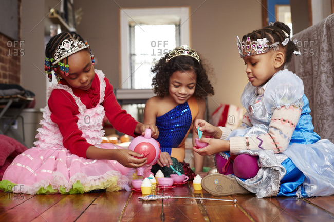 Girls playing dress-up at tea party