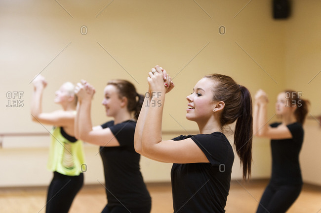 Dancers with hands clasped rehearsing in studio