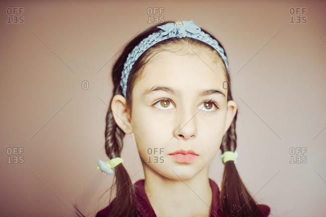 Girl wearing braid pigtails