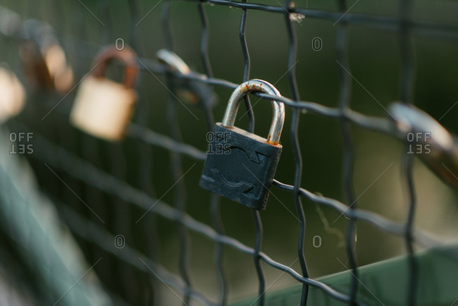 Close up of padlocks on a fence
