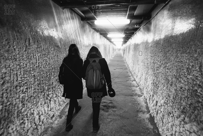 Durgau-Valea Sarata, Romania - February 8, 2015: Two people walking through a tunnel in a salt mine