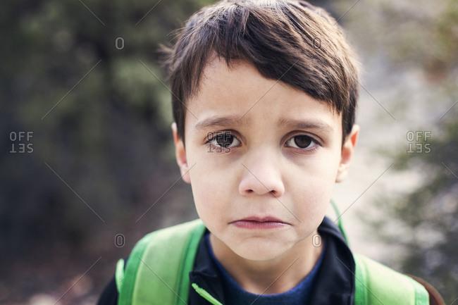 Portrait of a little boy pouting