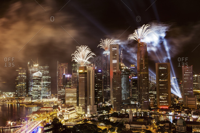 Fireworks bursting over skyscrapers in Singapore