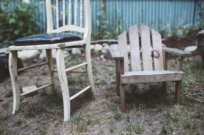 Wooden chairs in a yard