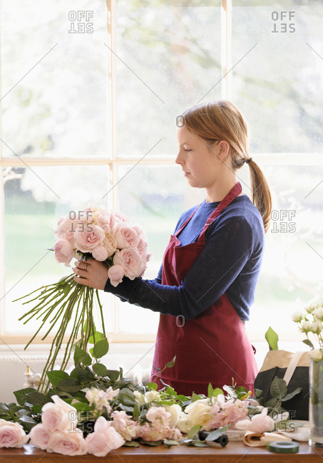 Florist arranging roses