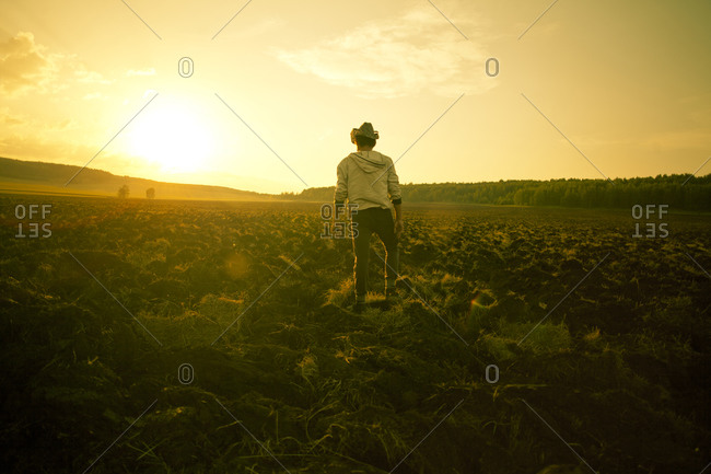 Man standing in rural field