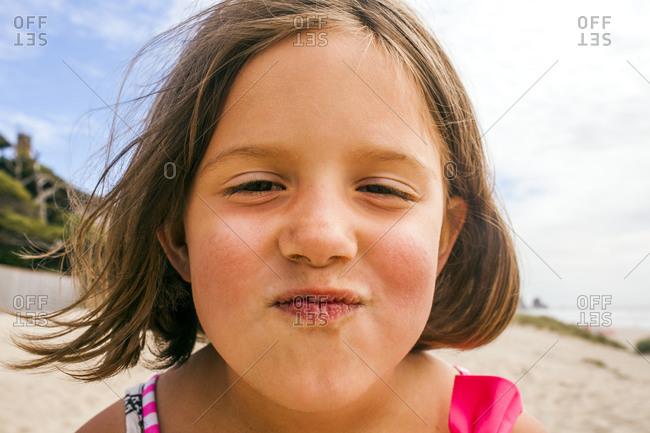 Girl making face on beach