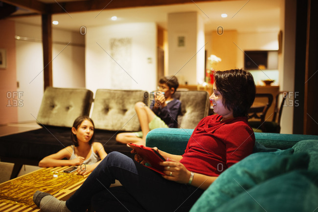 Family relaxing together in living room