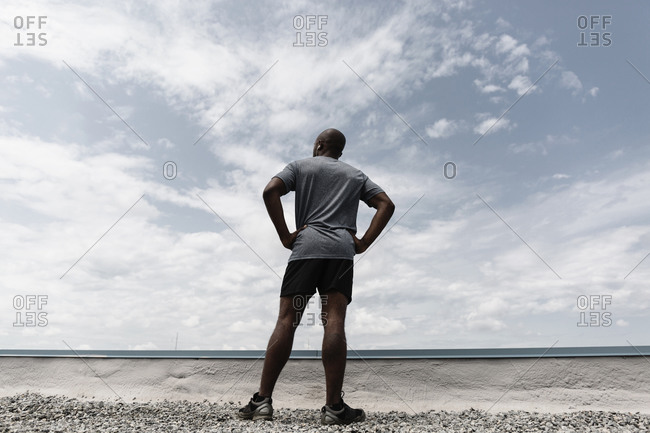 Runner contemplating landscape