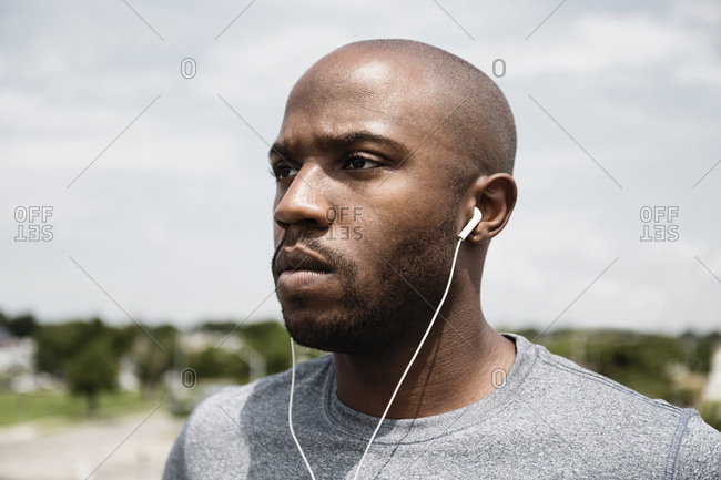 Runner listening to ear buds