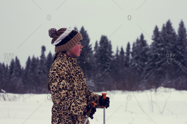 Boy cross-country skiing in snowy landscape