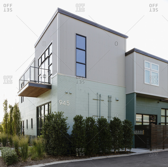 Modern condo building and parking lot
