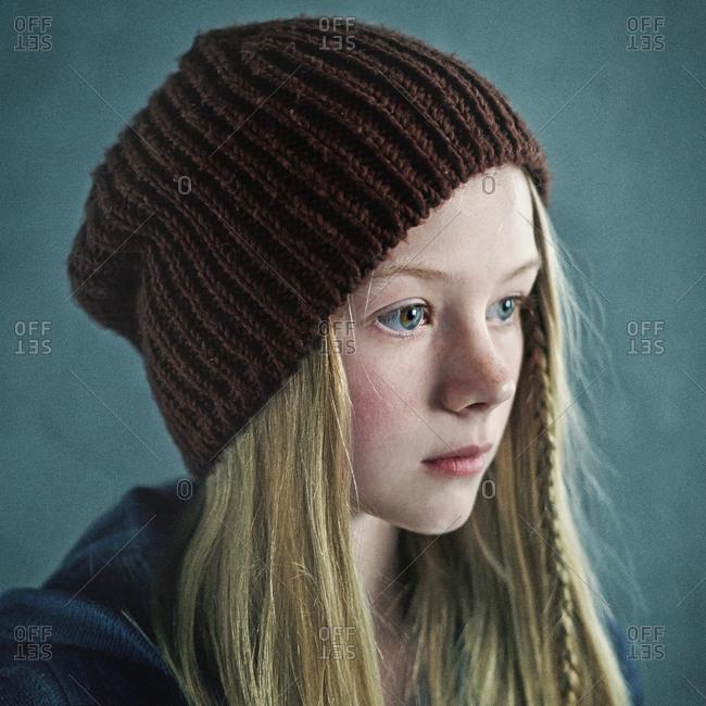 Teenage girl wearing knitted cap