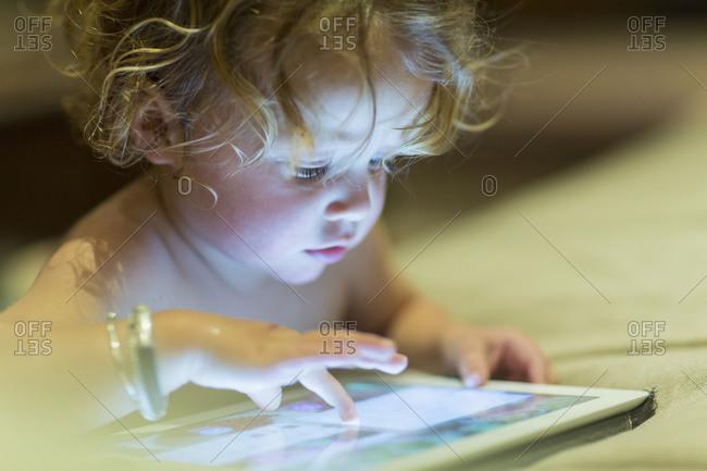 Baby using digital tablet - Offset