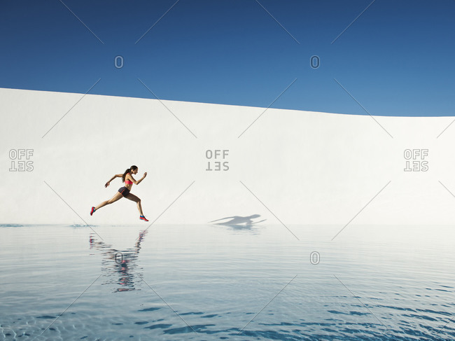 Woman running on water surface