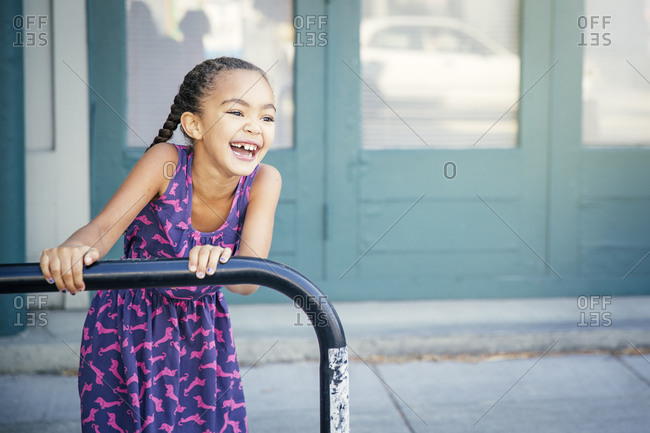 Girl playing on bicycle rack