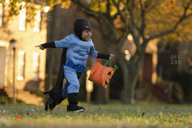 Boy trick-or-treating on Halloween