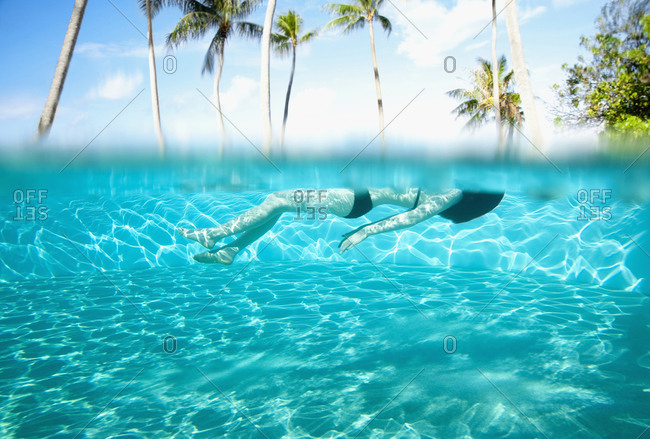 Pacific Islander couple swimming in pool