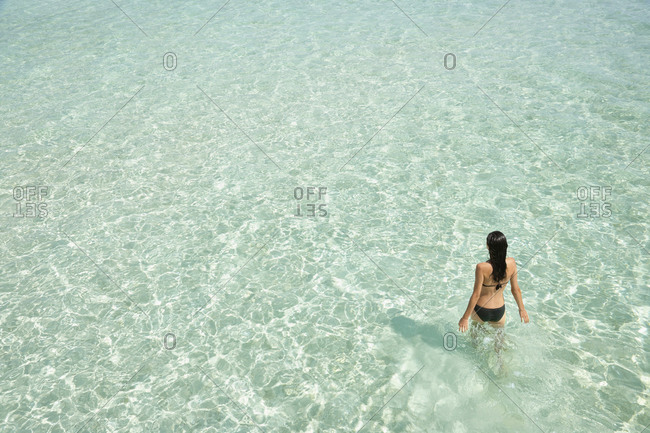 High angle view of Woman standing in tropical ocean