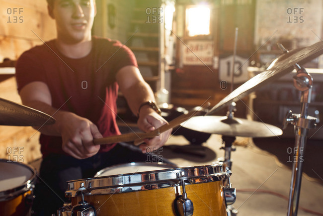 A boy at a drum set