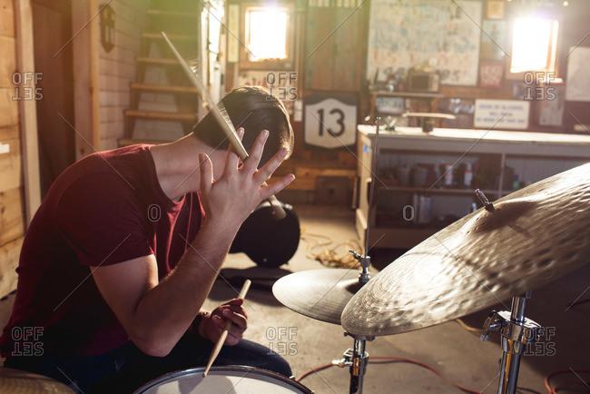 Teen boy at a drum set