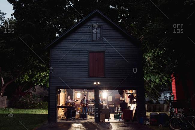 Teen band practicing in garage