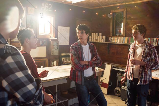 Teen boys collaborating in garage