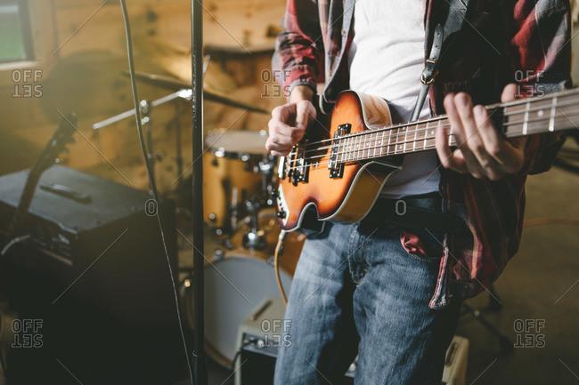 Teen playing an electric guitar